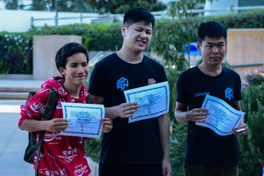 First, second, and third place winners of the One-Handed 3x3 cubing event from the Speed Cube Competition that took place on Saturday, Sept. 28, 2019 on west campus at City College in Santa Barbara, Calif. Max Park (middle) took first with a time of 9.92 seconds, Mulun Yin (right) took second with a time of 14.38 seconds, and Will Hamilton (left) took third with a time of 14.74 seconds.