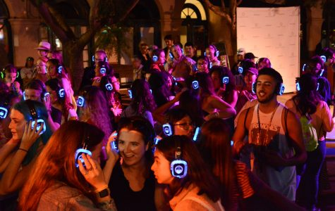 SBCC and UCSB students dance and socialize at the silent disco during College Night Out at Paseo Nuevo Mall on Tuesday, Sept. 24, 2019, in Santa Barbara, Calif. Dozens of students gathered to mingle, win prizes and hang out during the 3 hour event put on by City College.