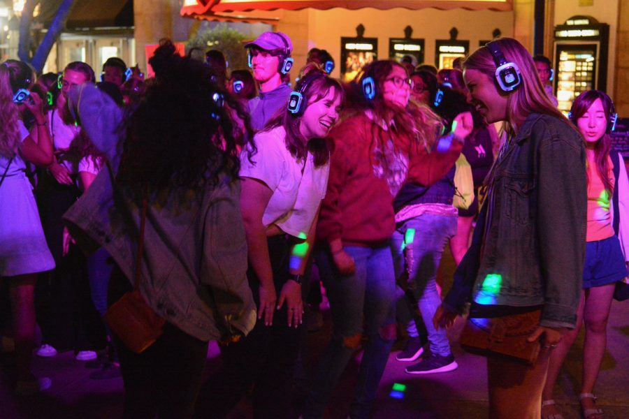 SBCC and UCSB students dance and socialize at the silent disco during College Night Out at Paseo Nuevo Mall on Tuesday, Sept. 24, 2019, in Santa Barbara, Calif.