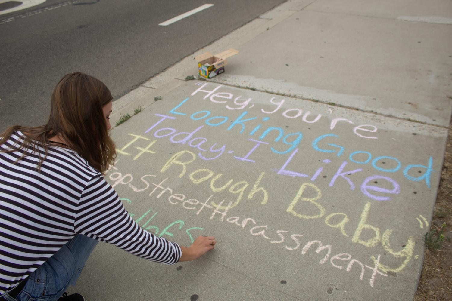 City College student Rebeca Adam chalks a quote from a sexual harassment story at Santa Barbara City College in Santa Barbara, Calif., on Thursday, Sept. 26, 2019. She chalks sidewalks at least three times a week to share stories of sexual harassment and assault that are messaged to her on her instagram, @catcallsofsantabarbara.