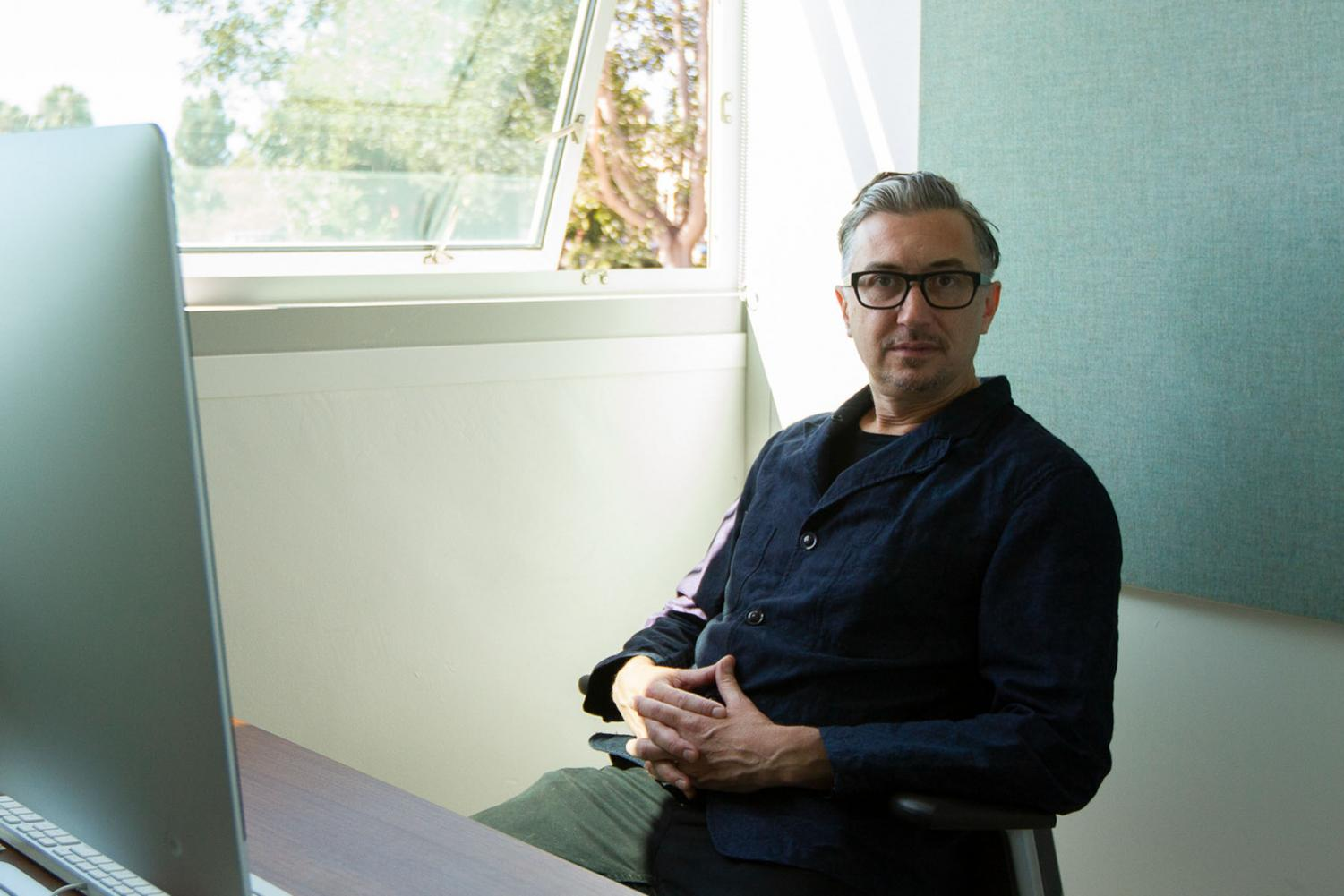 John Connelly sits in his office as the new Director of The Atkinson Gallery on Wednesday, Sept. 11 2019, in the Humanities Building at City College in Santa Barbara, Calif.