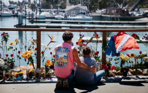 """Cherie McDonough is comforted by a loved one while grieving the death of her 25 year-old daughter Alexandra Kurtz, at a memorial remembering the 34 victims killed in a boat fire on Tuesday, Sept 3, 2019 next to Sea Landing in Santa Barbara, Calif. """"She followed her dream,"""" said McDonough, """"This is where she was happy at."""""""