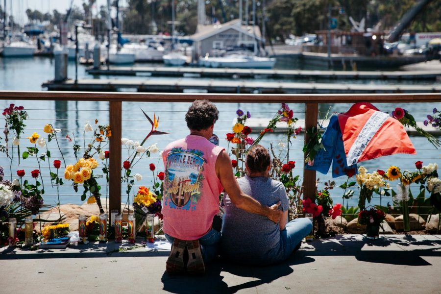 "Cherie McDonough is comforted by a loved one while grieving the death of her 25 year-old daughter Alexandra Kurtz, at a memorial remembering the 34 victims killed in a boat fire on Tuesday, Sept 3, 2019 next to Sea Landing in Santa Barbara, Calif. ""She followed her dream,"" said McDonough, ""This is where she was happy at."""