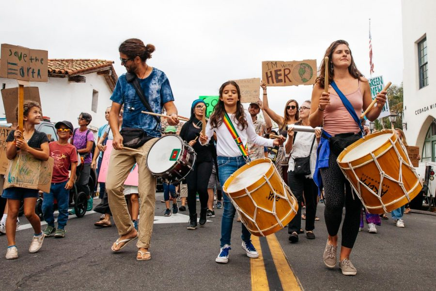 From+left%2C+drummers+Marceu+Lima%2C+Manoela+Figuer+and+Sofia+Smith+Hale+lead+the+climate+strike+march+towards+State+Street+from+De+La+Guerra+Plaza+on+Friday%2C+Sept.+27%2C+2019%2C+in+Downtown+Santa+Barbara%2C+Calif.+Lima+started+the+Os%C3%A9-Afro+Brazialin+Drumming+Group+1+year+ago+and+believes+drums+help+people+stay+motivated+in+a+march+and+create+a+strong+energy.+