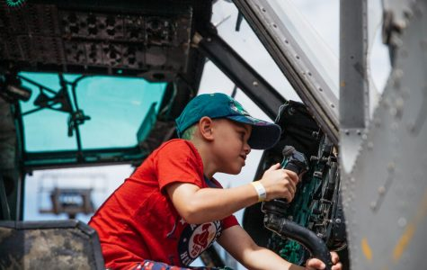 A local child fidgets with gadgets and controls of the retired UH-1M war helicopter brought to Touch a Truck day by the Vietnam Veterans of America Corporation on Sunday, Sept. 22, 2019, in the West Campus parking lot at City College in Santa Barbara, Calif. The twin blade chopper named Huey, was used in the Vietnam War as a gunship and donated to the VVA by Gerry Roberson.