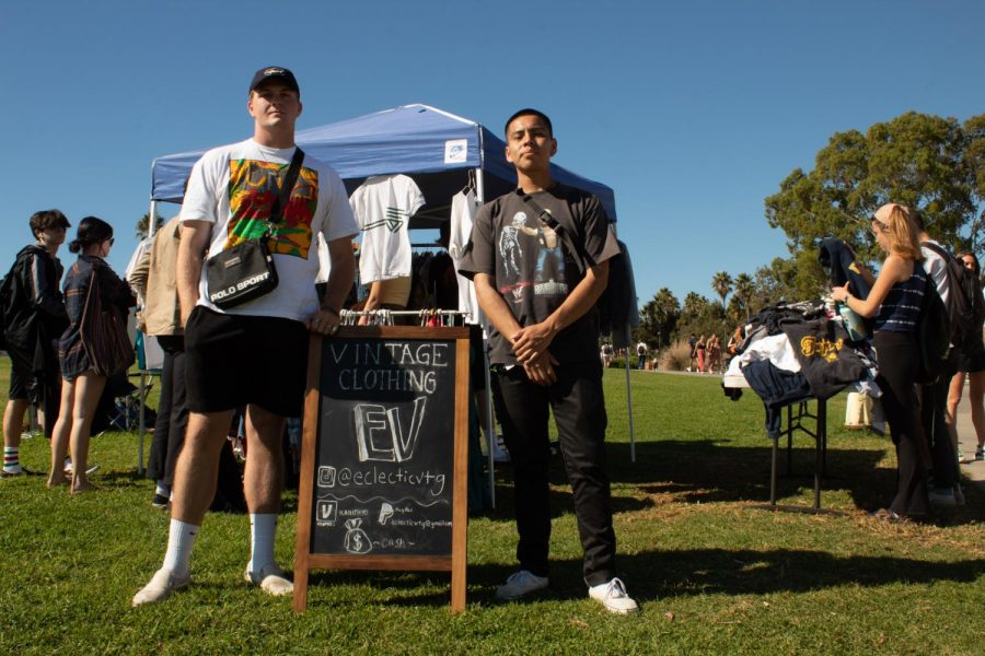 Kane Haskins (left) and Estevan Lucas (right) present their vintage clothing business Eclectic Vintage, where they sell t-shirts, hoodies and jackets at low prices on Wednesday Oct. 23, 2019, on the West Campus lawn at City College in Santa Barbara Calif. Haskins and Lucas set up shop every Wednesday near the Luria Library on the West Campus lawn.