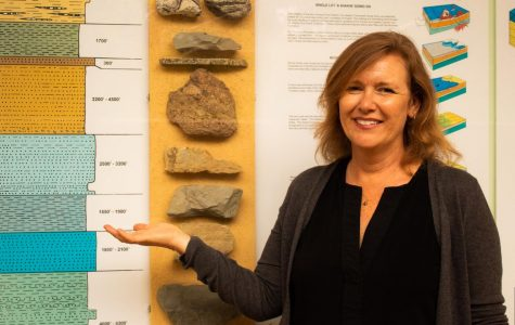Kristen Sneddon displays one of the various visual aids the Geology department has to offer in the Earth and Planetary Sciences Building on Wednesday, Sept. 25, 2019, at City College in Santa Barbara, Calif. Sneddon is the district four Santa Barbara City Council member and recently became a full-time faculty member at City College.