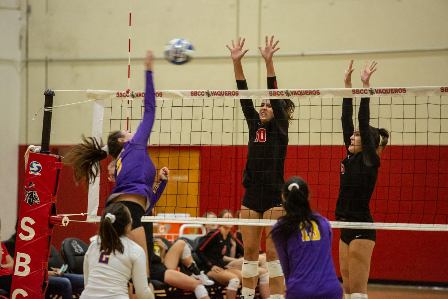 Vaqueros players Gabi Brewer (No.10) and Jordan Falconer (No.6) leap over the net to defend the opponents strike on Tuesday, Oct. 2, 2019, in the Sports Pavilion at City College in Santa Barbara Calif. The Vaqueros beat Cal Lutheran JV 3-0.
