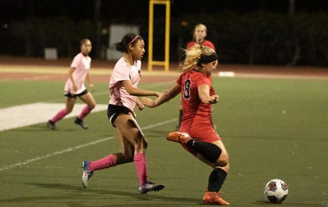 Molly Branigan (No9) getting the ball away from Kayla Acosta (No4) on Thursday, Oct. 17, 2019, at La Playa Stadium at City College in Santa Barbara, Calif. The Vaqueros beat La Pierce college 2-0.