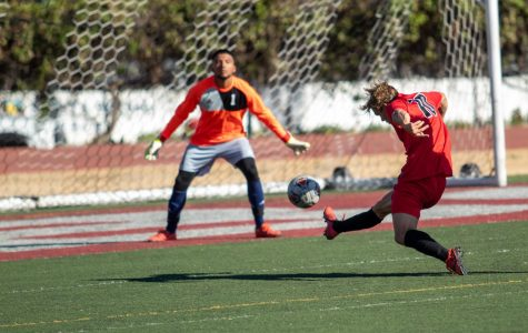 Christopher Robinson (No.10), getting his shot off but Miguel Granados (No.1), stopped the shot from scoring on Oct. 25, 2019, at La Playa Stadium at City College in Santa Barbara, Calif.