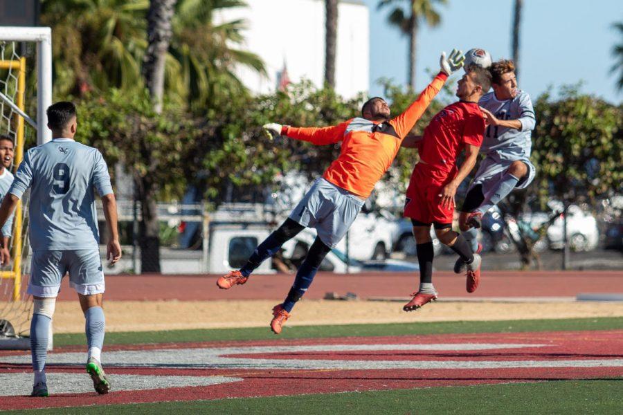 Wayne MCclellan (No.7) tries to shoot into the goal but multiple defenders contest him on Friday, Oct. 25, 2019, at La Playa Stadium at City College in Santa Barbara, Calif.