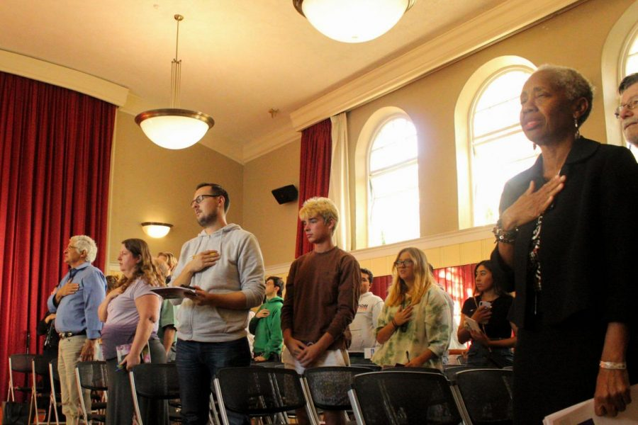 Helen Benjamin (right) stands for the Pledge of Allegiance along with students, board members and people of the community for the State of the College presentation to the community on Oct. 3, 2019, at the Schott Campus in the James Tannahill Auditorium in Santa Barbara, Calif.