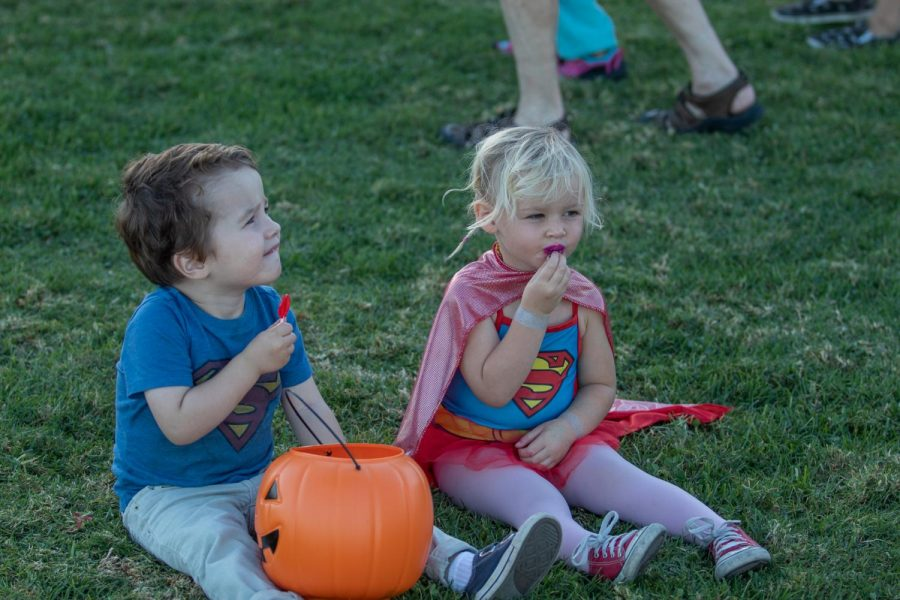 From left 2 year-olds Gabriel Pelton and Keona Dato enjoy candy from the Trunk or Treat festival on Friday, Oct. 25, 2019, on West Campus at City College in Santa Barbara, Calif. The festival was made for kids to enjoy quality time with loved ones.