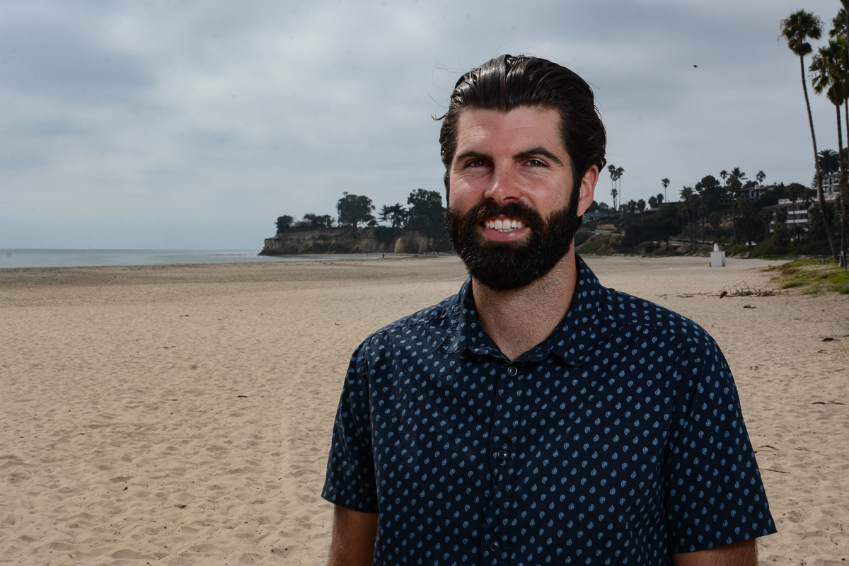 Former city college student Oliver Aquilon stands on the beach where he gets his inspiration for his art on Wednesday, Oct. 9, 2019, on Leadbetter Beach in Santa Barbara, Calif. Aquilon is a painter and also makes sculptures out of driftwood in his garage here in Santa Barbara, Calif.