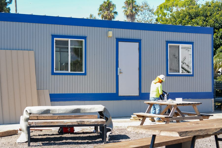 Workers finalized the new City College Food Pantry building by caulking and sealing the outside to ensure durability on Monday, Oct. 7, 2019, on East Campus at City College in Santa Barbara, Calif.