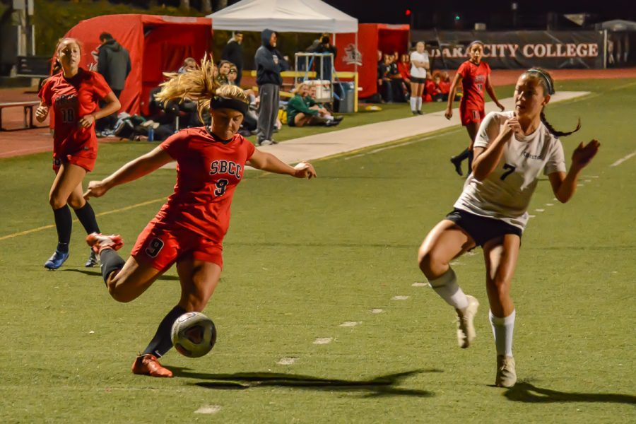 Midfielder Molly Branigan (No. 9) crosses the ball past defender Alley Andrade (No. 7) to her teammates near the goal during the Vaquero's game against the Cuesta Cougars on Tuesday, Oct. 29, 2019, at La Playa Stadium at City College in Santa Barbara, Calif. The Vaqueros won the game 4-1 from Branigan's goal and a hat trick from teammate Mekaylla White.