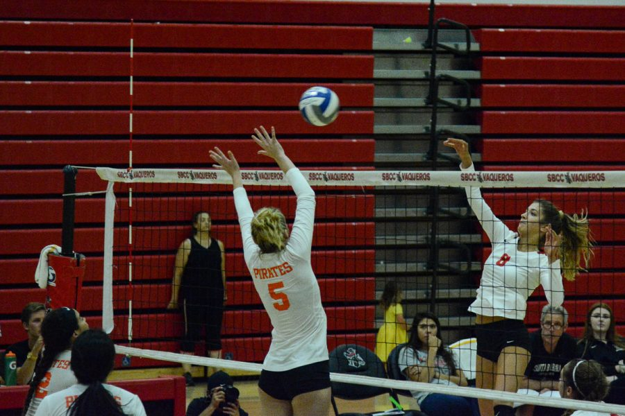 Makenzie Phelps (No. 8) hits the ball past middle blocker Tatum Teel (No. 5) during the third set of the Vaqueros match against the Pirates on Friday, Oct. 4, 2019, in the Sports Pavilion at City College in Santa Barbara, Calif. The Vaqueros lost 3-1.