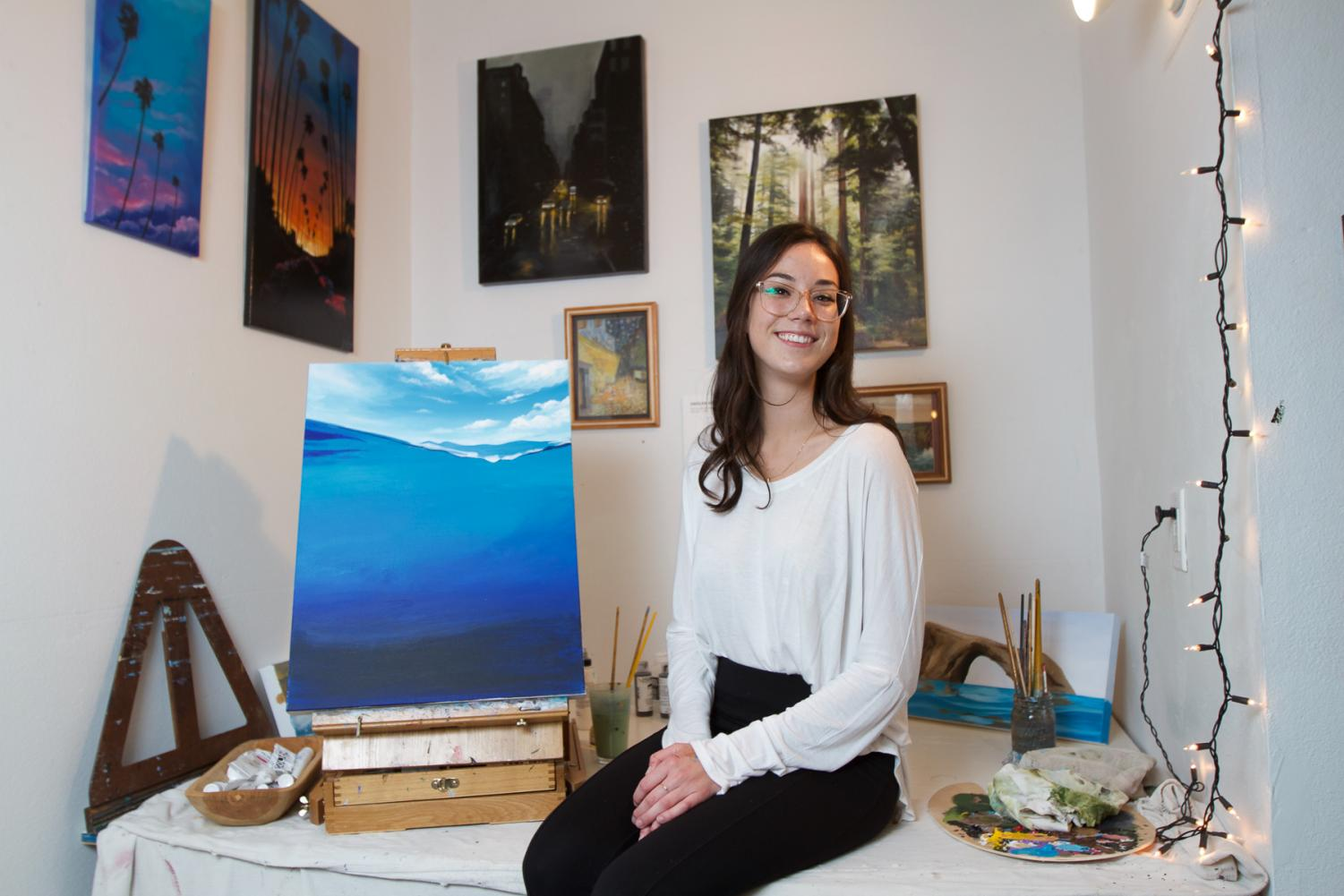 Artist and marine biology major Havilah Abrego sits in her private home art studio on Thursday evening, Oct. 17, 2019, in Ventura, Calif. Abrego has developed her artistic passion through the inspiration of her father and grandfather's artwork.