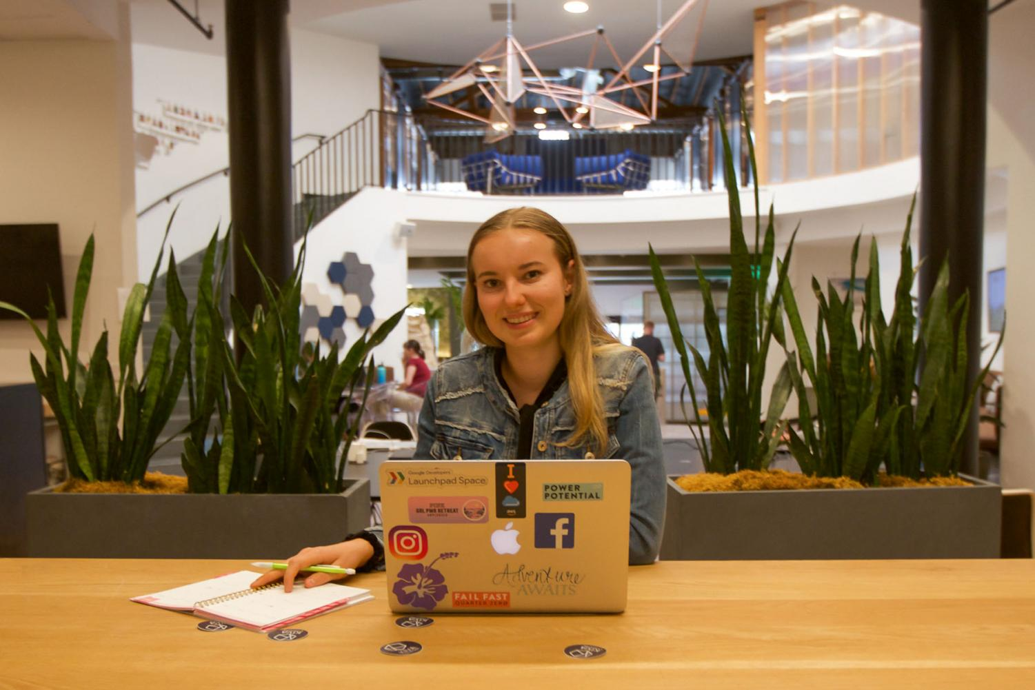 18 year-old former dual-enrollment City College student Amanda Moores, works on the development of her business Flora, in her typical workspace at Kiva Coworks on Wednesday, Oct. 16, 2019, in Santa Barbara, Calif. Flora will be an app designed to boost wellness and reduce stress levels.