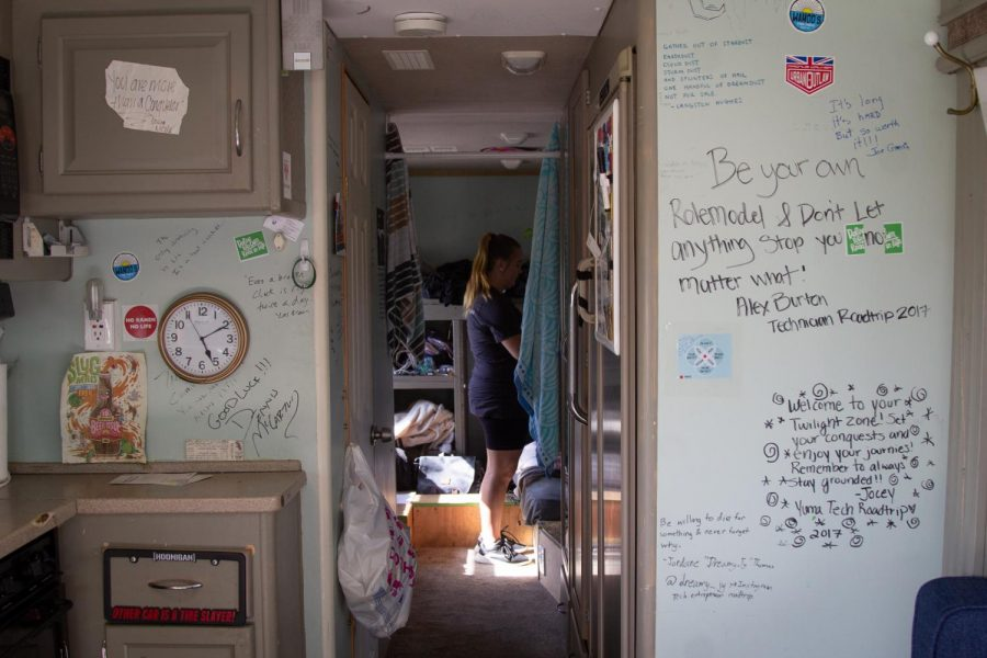 Alli Brinkerhoff stands inside the Roadtrip Nation RV where four explorers will sleep after their pit stop at City College in Santa Barbara, Calif., on Thursday, Oct. 10, 2019.