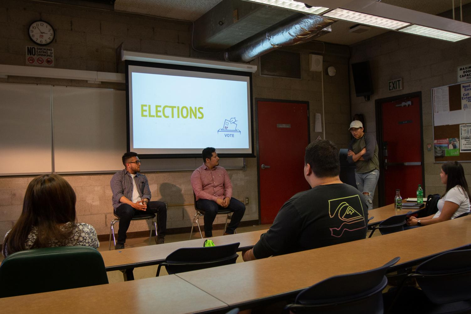 From left, Tyler Valderrama and Christopher Patzan-Lopez run for academic chair at the Society of Hispanic Professional Engineers (SHPE) Fall 2019 club election on Friday, Oct. 11, 2019, in Room 130 of the Physical Science building at City College in Santa Barbara, Calif.