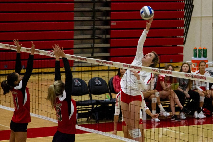 Madi Mullins (No.11) hits and scores a point for the Lady Vaqueros contributing to the 3-0 win against LA Pierce College on Wednesday, Oct. 9, 2019, in the Sports Pavilion at City College in Santa Barbara, Calif.