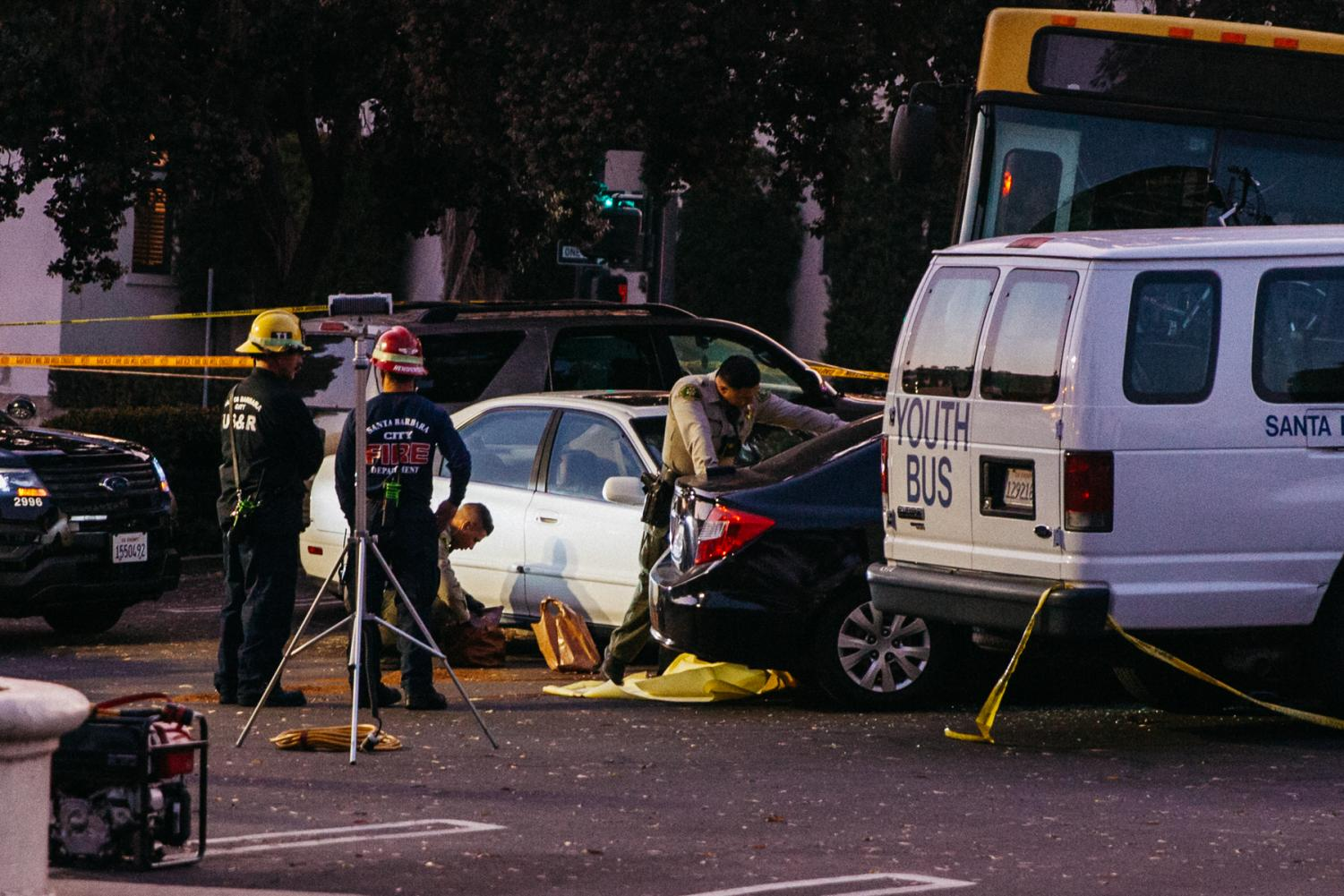 Santa Barbara Authorities and first responders prepare to remove the covered body of the woman killed by MTD bus 907 on Wednesday, Oct. 9, 2019, on Chapala and West Figueroa Street in Downtown Santa Barbara, Calif.