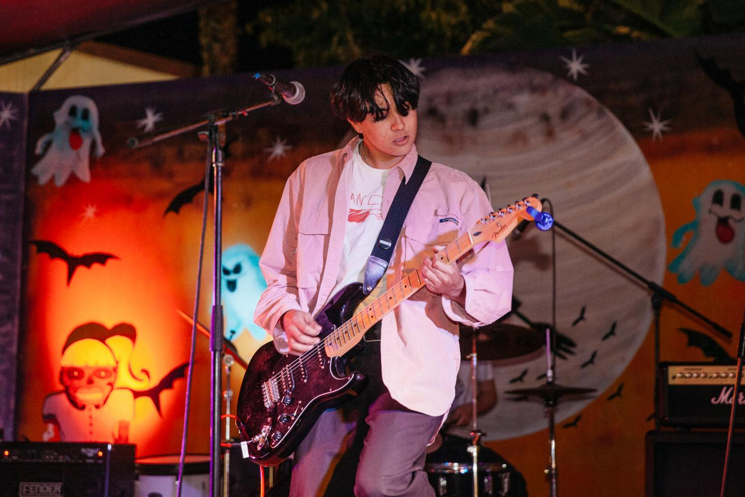 """ExPorter lead guitarist and City College student Alec Cavazos Plays guitar at the ExPorter performance at """"The Haunt & Harvest Festival"""" on Friday Oct. 18, 2019 at the Earl Warren Showgrounds in Santa Barbara, Calif."""