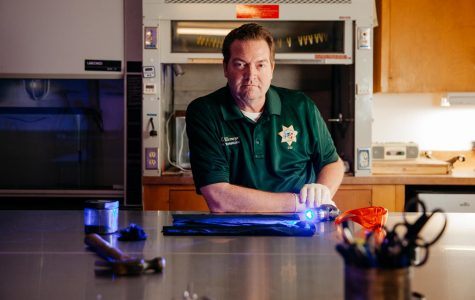 Senior Forensic Technician and adjunct City College Instructor Mike Ullemeyer sits with forensic analysis tools at the evidence table in the crime lab in the Sheriff's County Office on Friday, Oct. 25, 2019, in Santa Barbara, Calif. Ullemeyer teaches introduction to forensics at City College and has played key roles in the investigation of recent cases like the Conception boat fire and the Hope Ranch stabbing for the Sheriff's Department.