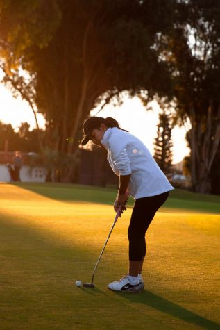 Pratima Sherpa aligns her put down the hole 3 putting green at the Santa Barbara Golf Club for her 18 hole practice game early Wednesday, Oct. 23 in Santa Barbara, Calif.