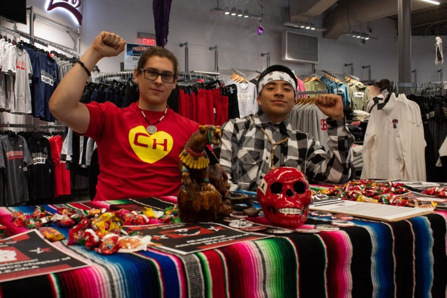 From Left, Diego Lazcano and John Esteban set up in the Campus Bookstore to represent the MEAChA Club and reach out to students to share their culture and enlighten others about who they are and what they stand for on Oct. 31, 2019, at City College in Santa Barbara, Cailf.