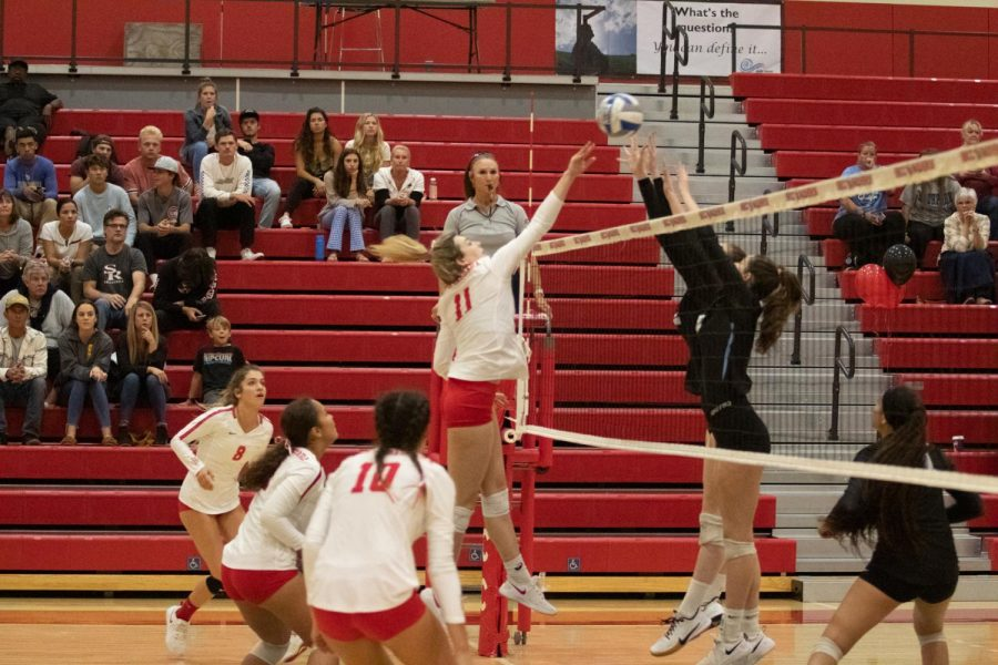 Madi Mullins(No.11) strikes the ball down and scores a point for the Vaqueros on Friday, Nov. 8, 2019 in the Sports Pavilion at City College in Santa Barbara, Calif.