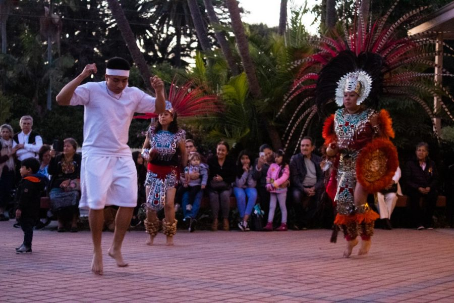John Esteban (left) performs a dance to honor his culture and ancestors on Oct. 29, 2019, at the local St. Raphael Catholic Church in Goleta, Calif. John Esteban (left) performs a dance to honor his culture and ancestors on Oct. 29, 2019, at the local St. Raphael Catholic Church in Goleta, Calif.