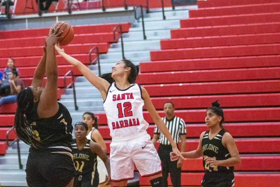 Sophia Torres (No.12) blocks Breanna Thomas (No.5) on Sunday, Nov. 3, 2019, in the Sports Pavilion at City College in Santa Barbara, Calif. The Vaqueros came out with a 76-56 win over Ohlone Community College.