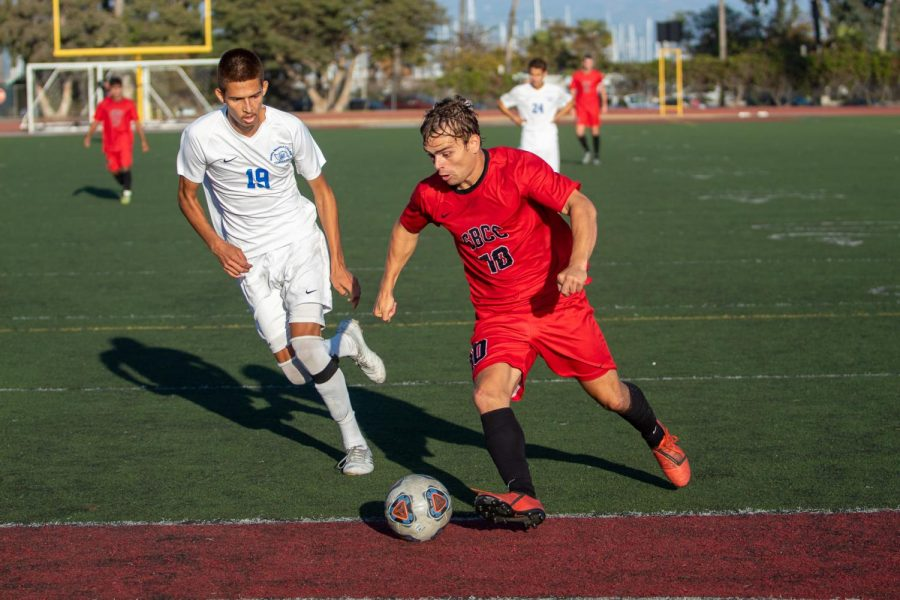 Christopher Robinson (No.10) makes his way towards the goal but Brandon Calderon Ruiz (No.19) tries to stop him on Sunday, Nov. 10, 2019, at La Playa Stadium at City College in Santa Barbara, Calif.