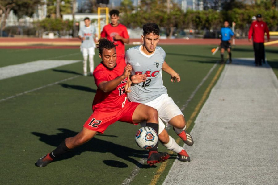 JahMikaili Hutton (No.12) tries to shrug off Bryan Oseguera (No.12) on Saturday Nov. 23, 2019, at La Playa Stadium at City College in Santa Barbara, Calif. After a long game the Vaqueros lost 3-1 in penalty Kicks against Santa Ana.