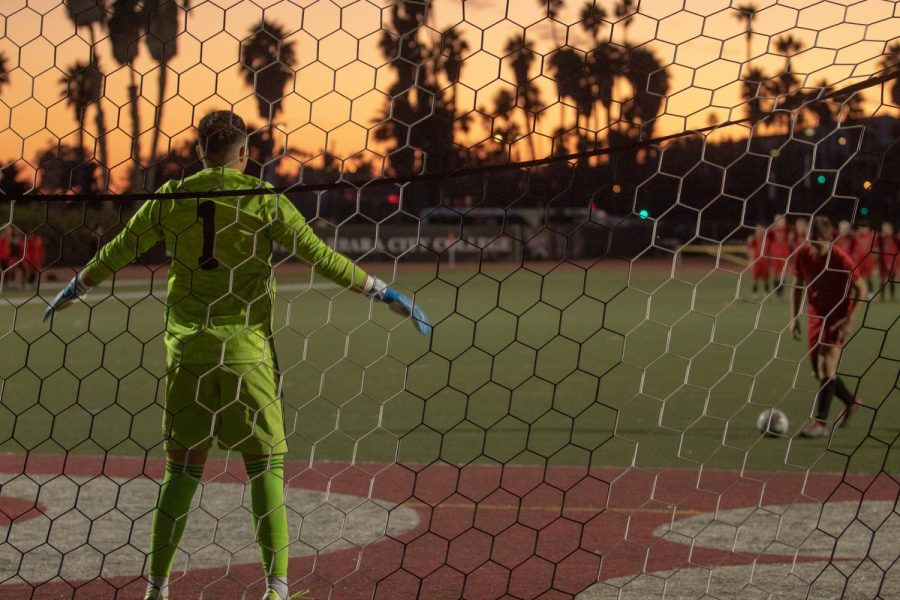 Frank Aguilar (No.1) prepares to successfully block Roni Spektor (No.5) on Saturday Nov. 23, 2019, at La Playa Stadium at City College in Santa Barbara, Calif.