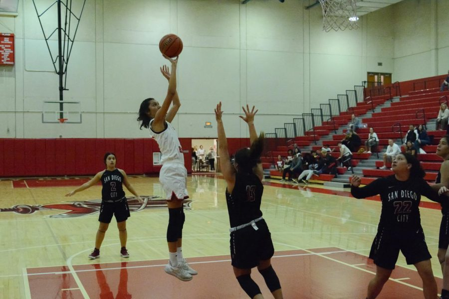 Sophia Torres (No.12) goes for a jump shot past San Diego City College defender Jazmine Lee (No.13) during the Vaqueros game in the Sports Pavilion Gym on Thursday, Nov. 7, 2019 at City College in Santa Barbara, Calif.