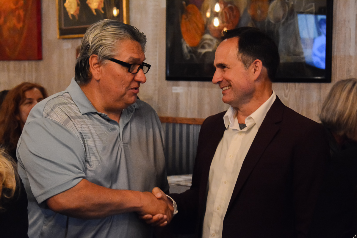 District 1 City Council Candidate Jason Dominguez (right) shaking hands with a campaign supporter after receiving results for the election on Tuesday, Nov. 5, 2019. Dominguez held a party at Uncorked Wine Tasting and Kitchen in downtown Santa Barbara, Calif.