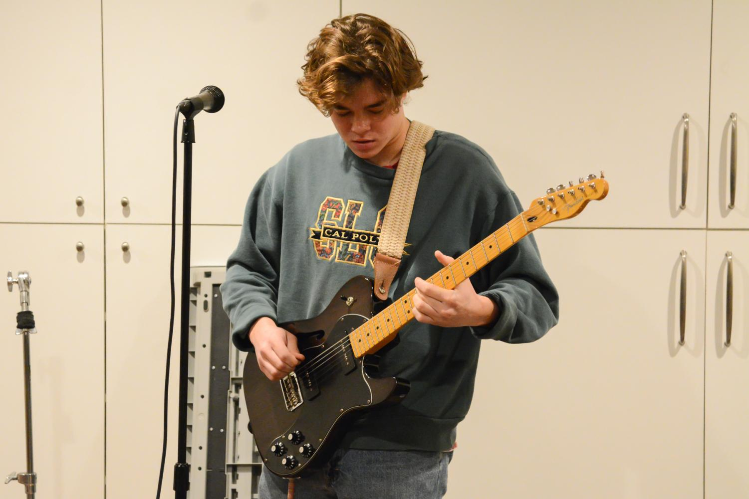 Lead singer and guitarist for the band Lizard's Mouth Cameron Meza performs their original song