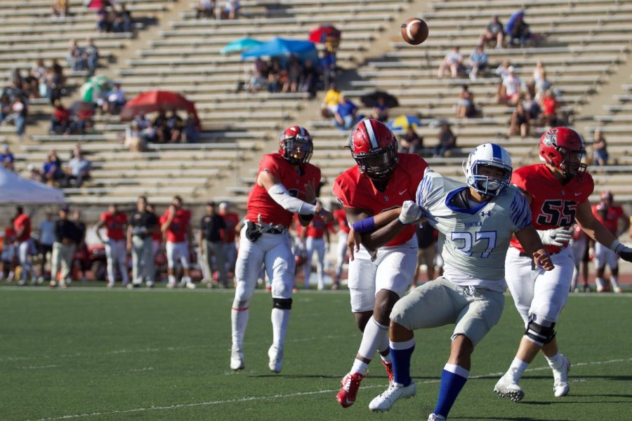 Quarterback Scotty Forbes (No.1) passes to the Vaqueros while his teammates, Will Bayonne (No.2) and Daniel Rivera (No.55), defend against the Spikes on Saturday afternoon, Nov. 2, 2019, at La Playa Stadium at City College in Santa Barbara, Calif. The Vaqueros lost their last home game 13-28 to the Allan Hancock College Spikes.