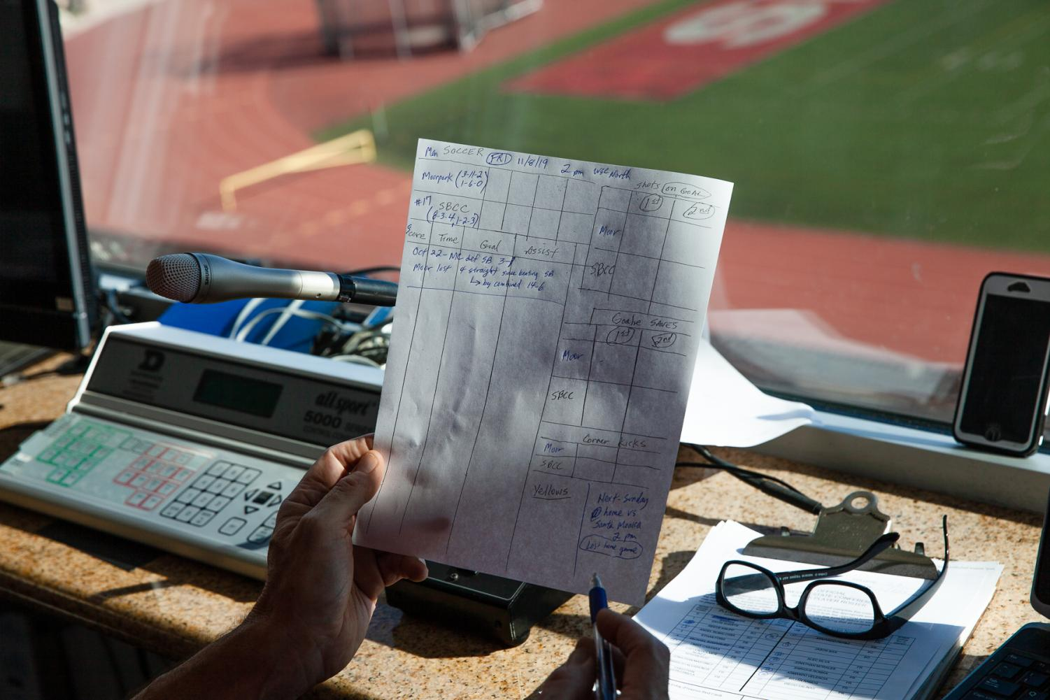 Dave Loveton looks over his structure sheet for stats before the City College soccer game against Moorpark on Friday, Nov. 8, at City College in Santa Barbara, Calif.