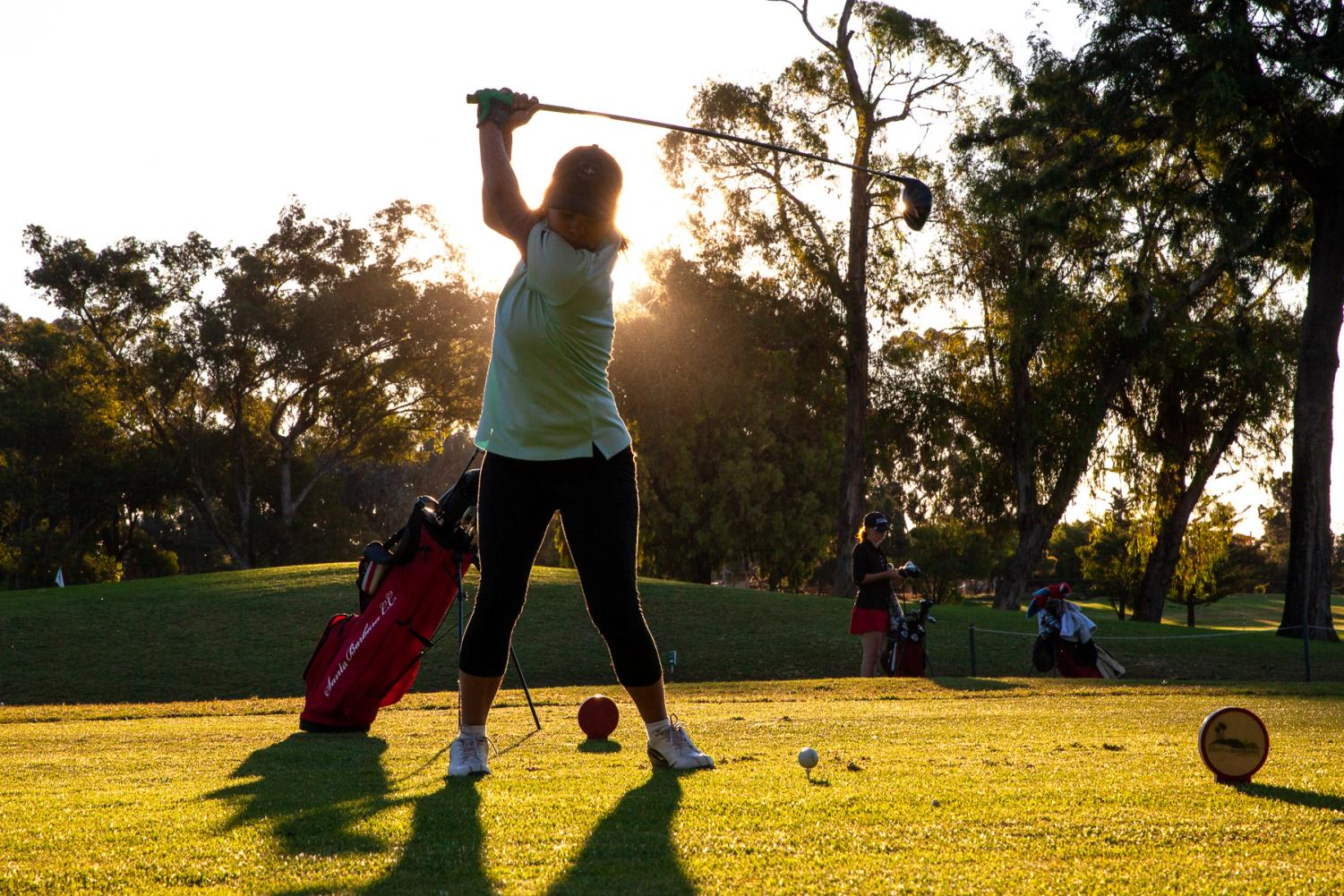 Pratima Sherpa swings to drive the ball down the fairway at the Santa Barbara Golf Club for her 18 hole practice game early Wednesday, Oct. 23 in Santa Barbara, Calif.