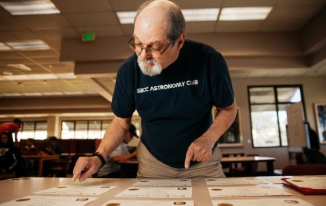 David Salvia organizes the 11 associate degrees and two certificates he received from City College over the last 13 years in the Luria Library on Thursday, Oct. 31, 2019, at City College in Santa Barbara, Calif. Salvia is 72 years-old and has been pursuing his love for learning at City College since 2006.