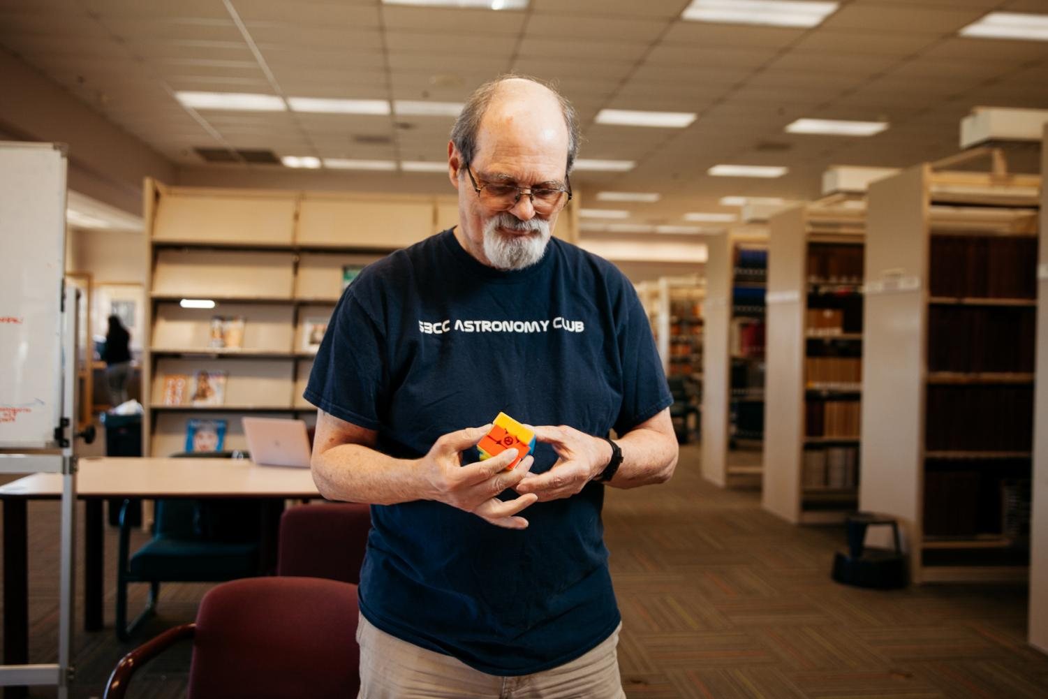"David Salvia solves his Rubik's cube in the Luria Library on Thursday, Oct. 31, in Santa Barbara, Calif. Salvia created the ""Salvia Method"" for solving Rubik's cubes and can solve a 3x3 cube in under ten seconds."