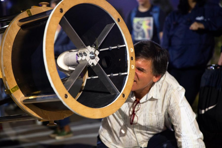 """Astronomy Professor Sean Kelly observes Venus through a 16"""" Dobsonian telescope built by the astronomy club on Friday, Nov. 22, 2019, on East Campus at City College in Santa Barbara, Calif. A Dobsonian telescope sits on a two-axis mount using two mirrors to magnify distant subjects, and is commonly used by amateur astronomers for its convenience and affordability."""
