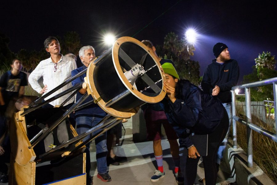 Astronomy Club member Mistea Adame follows a laser held by Robert Smith (second from right) with a Dobsonian telescope to locate and observe Jupiter on Friday, Nov. 22, 2019, on East Campus at City College in Santa Barbara, Calif. The Astronomy Club has been building the telescope for around 18 months and tested it with fellow City College students for the first time Friday.