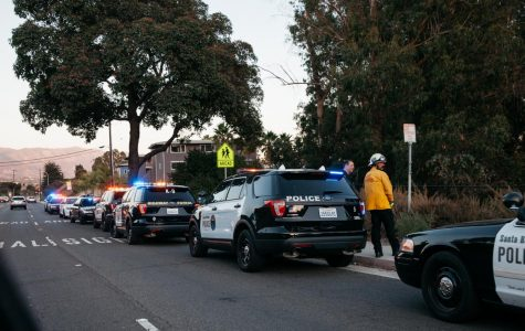 Police gather on Cliff Drive near Beach City in response to the armed shooter alert near City College on Wednesday, Oct. 30, 2019, in Santa Barbara, Calif. The suspect was unarmed and fled police due to a parole violation.