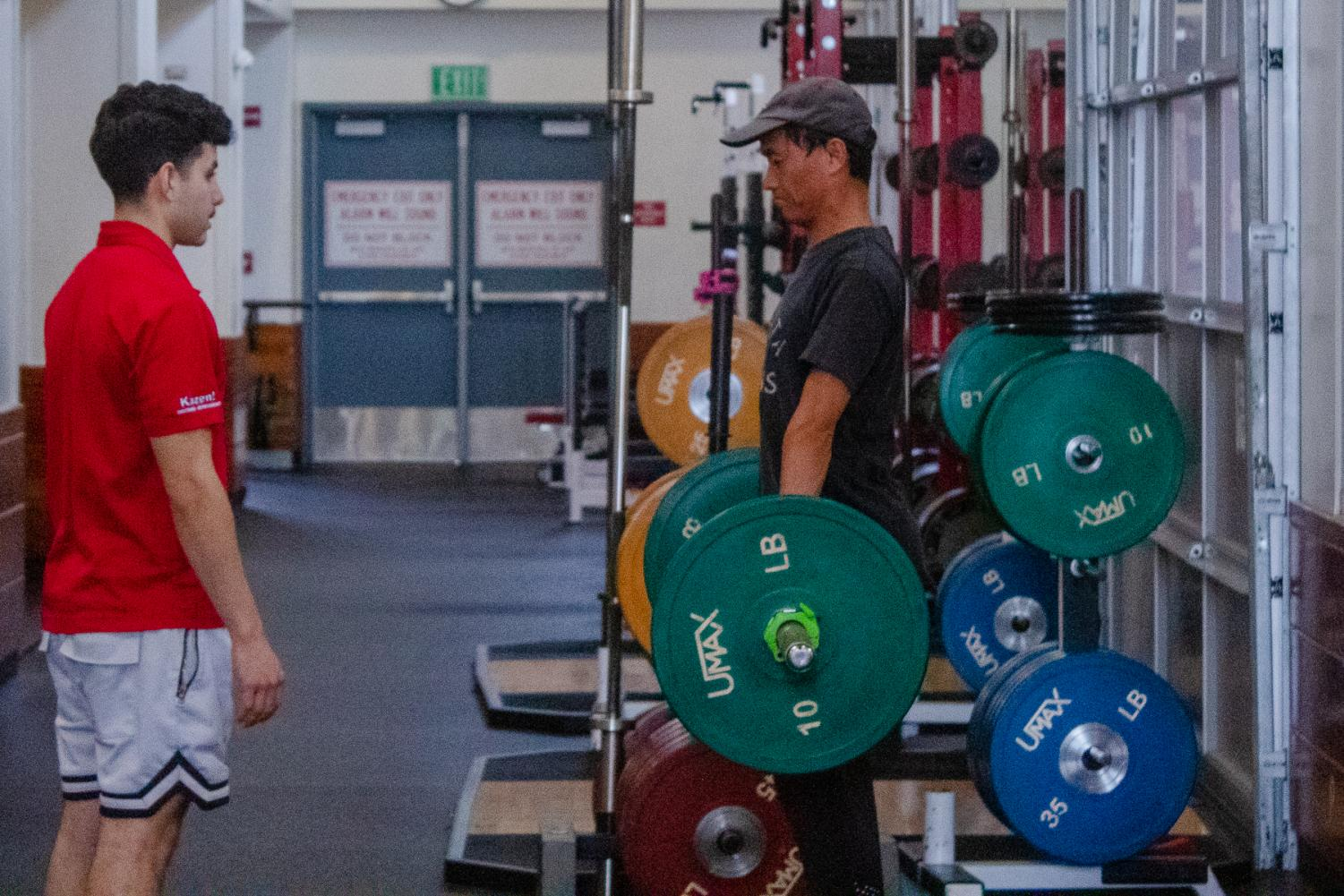 Joan Gao works on deadlift Position and stance under direction of Andrew Arnopole on Friday, Dec. 6, 2019, in the Life Fitness Center at City College in Santa Barbara, Calif.