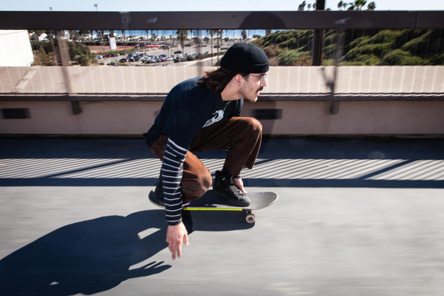 "Thomas Moore speeds down the campus bridge-way on Saturday, Nov. 23, from East to West Campus. ""I absolutely love bombing hills,"" said Moore ""it's like my favorite thing to do when I skate."""